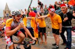 Hansen of Australia has a beer as he climbs the Alpe d'Huez mountain during the 172.5km eighteenth stage of the centenary Tour de France cycling race from Gap to l'Alpe d'Huez